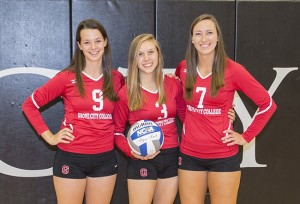 Galens (far right), with GC volleyball seniors Libbie Casey and Amy Trageser.
